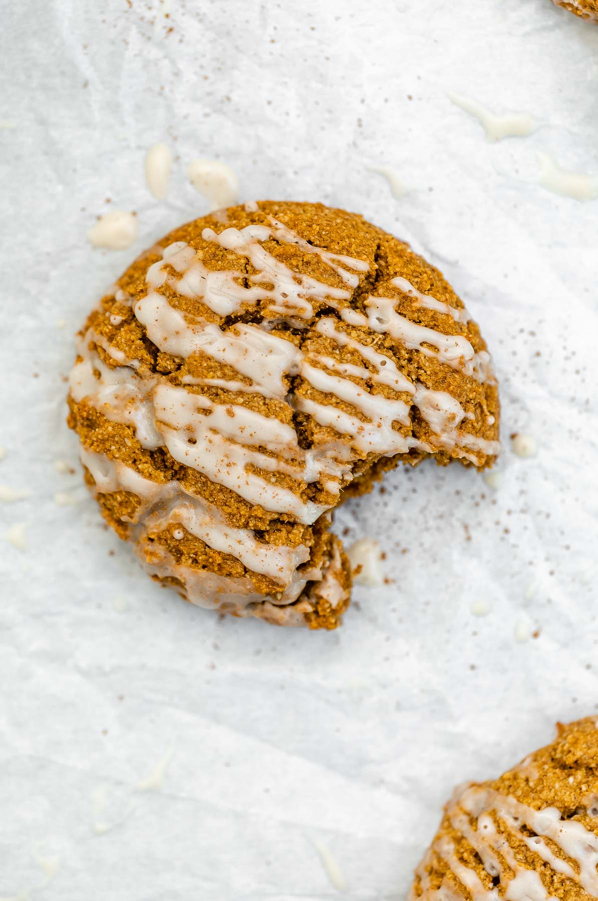 Overhead shot of one pumpkin cookie with cinnamon on top.