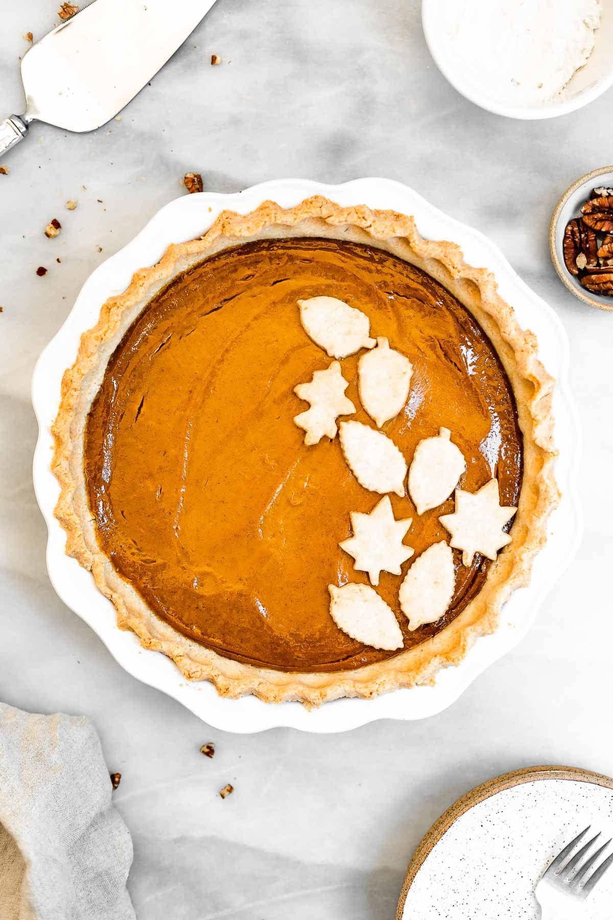 overhead shot of the final vegan pumpkin pie with cutout leaf crust.