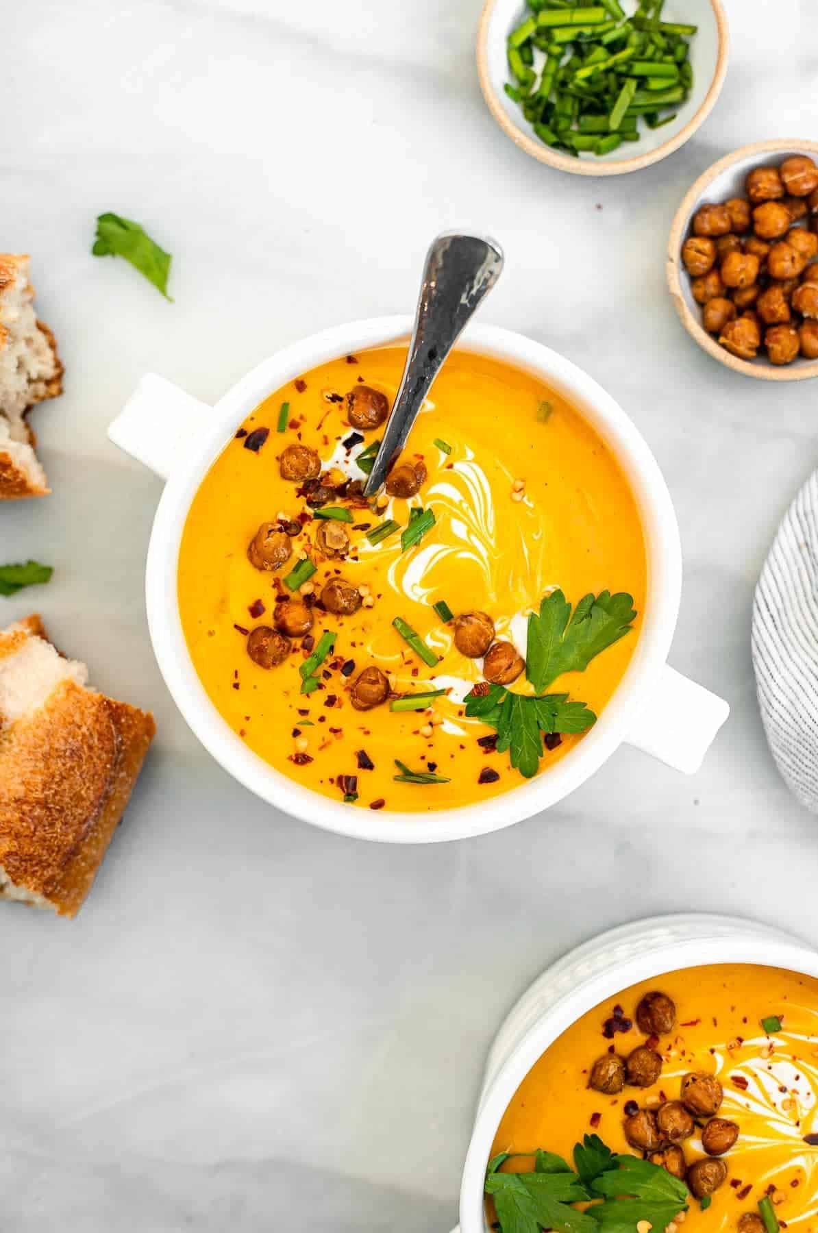 Overhead image of butternut squash soup with roasted chickpeas.