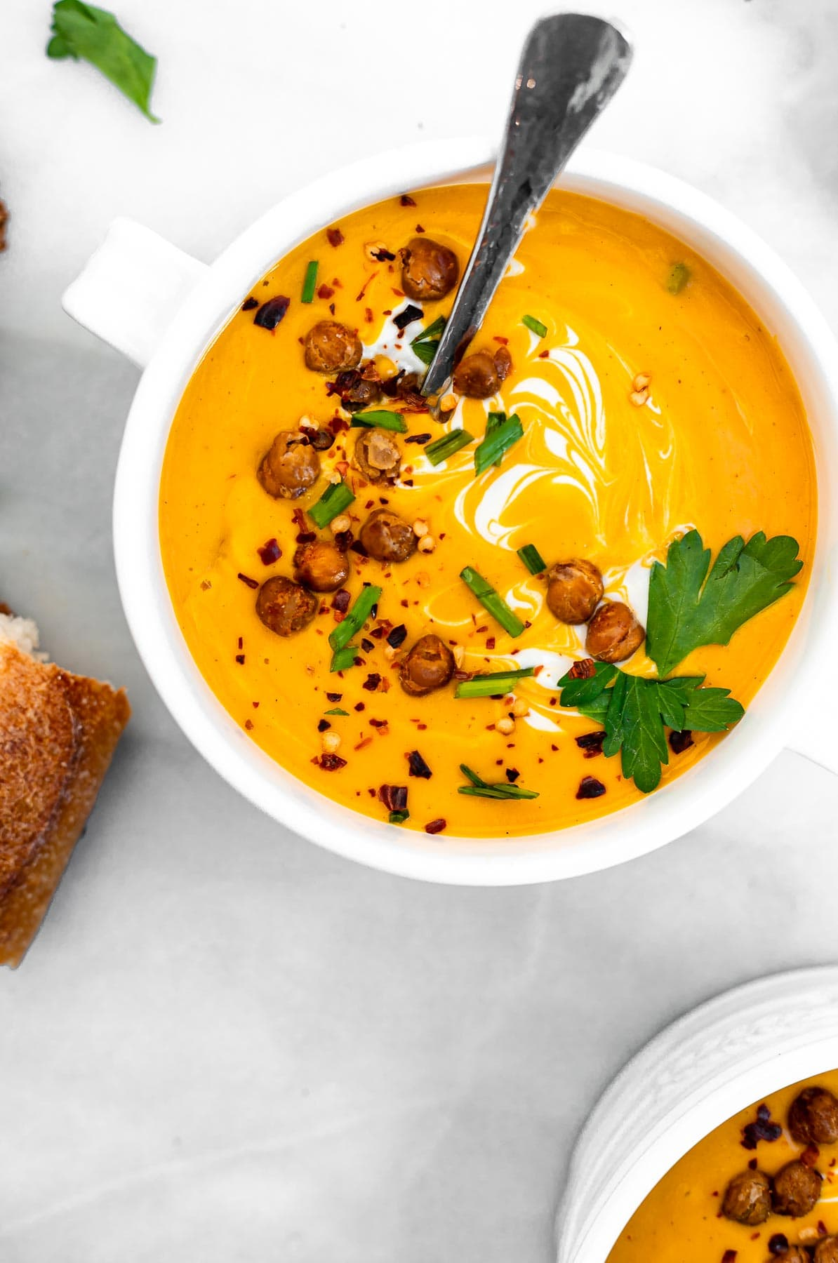 Vegan butternut squash soup with crispy chickpeas on top.