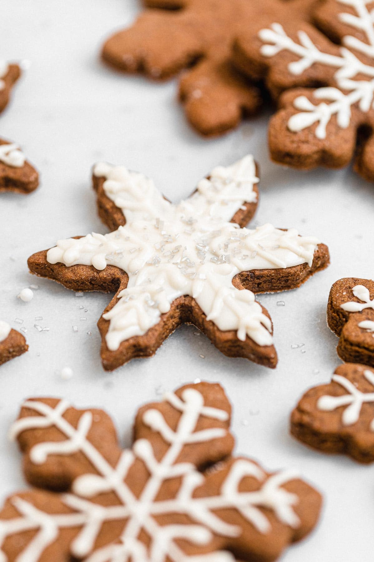 Vegan and gluten free snowflake gingerbread cookie with icing.