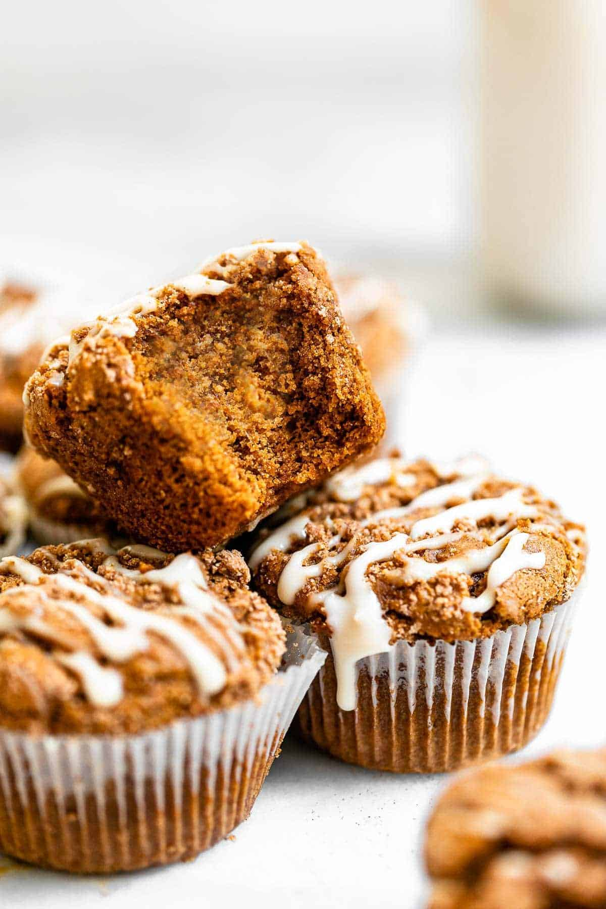 Stack of muffins with milk in the back.