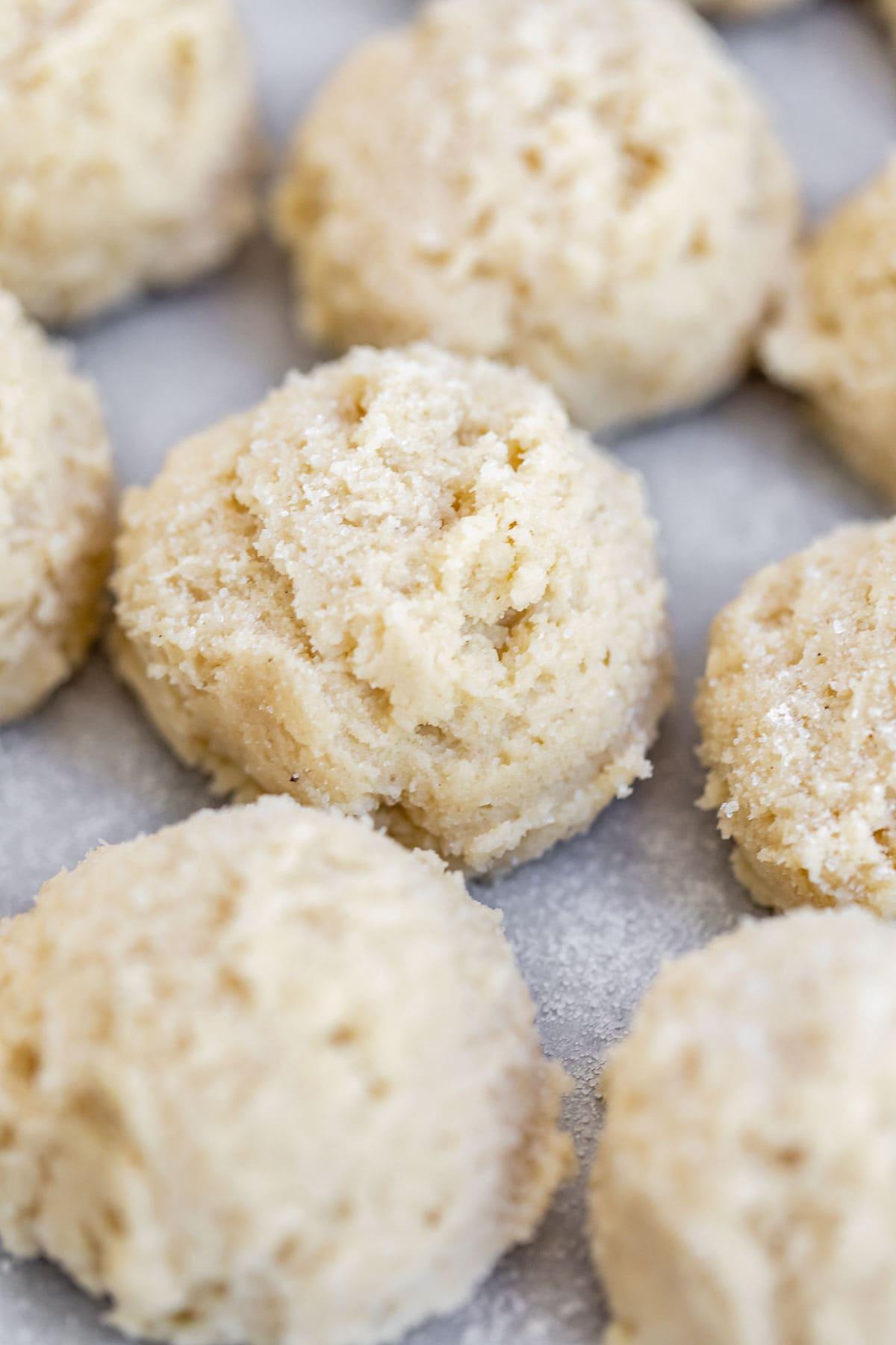 Dough in balls on a baking sheet.