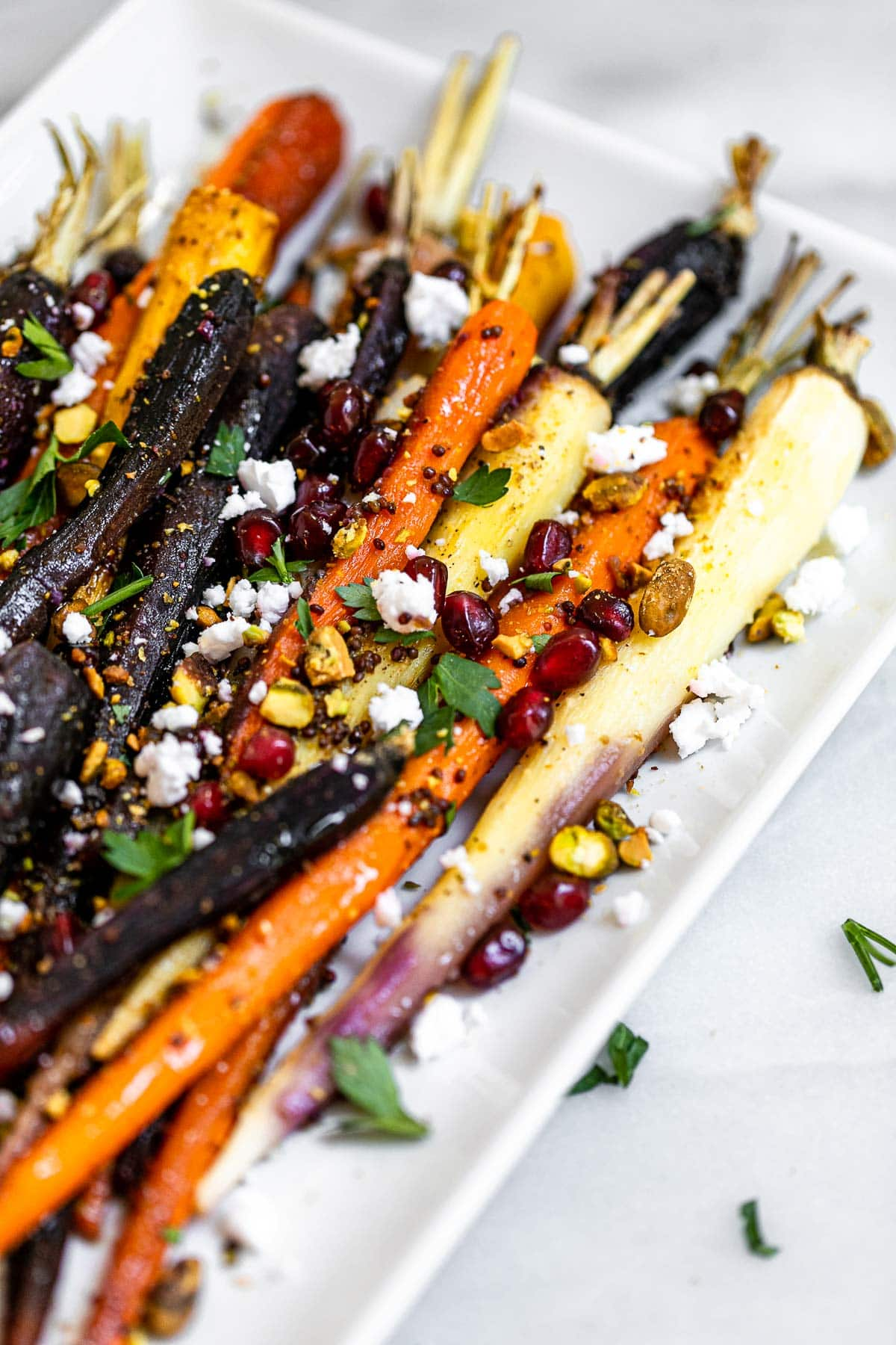 Maple glazed carrots with chopped pistachios and feta.