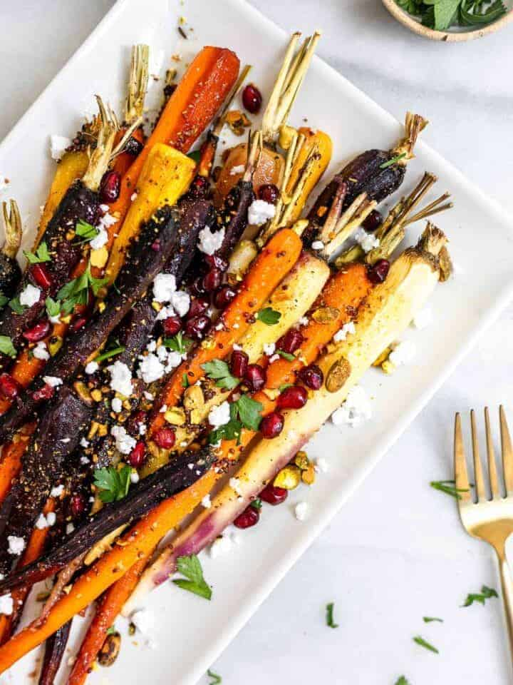Maple glazed rainbow carrots with feta and pomegranate.