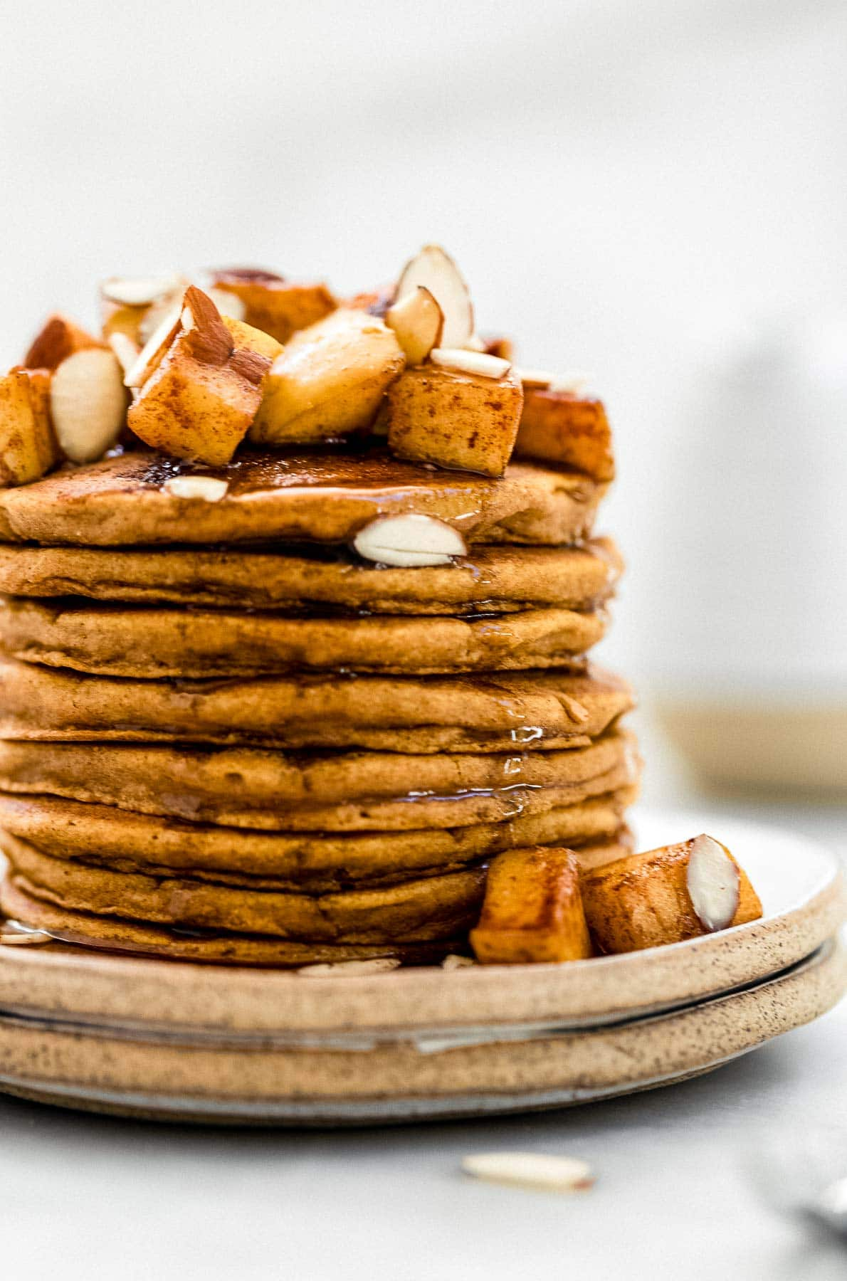Stack of vegan sweet potato pancakes with cinnamon apples.