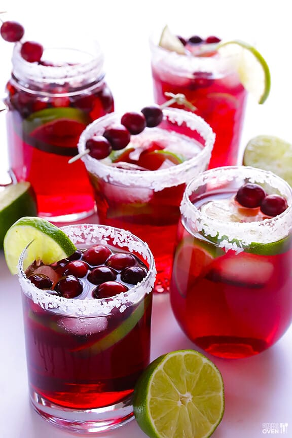 cranberry margarita with lime wedges.