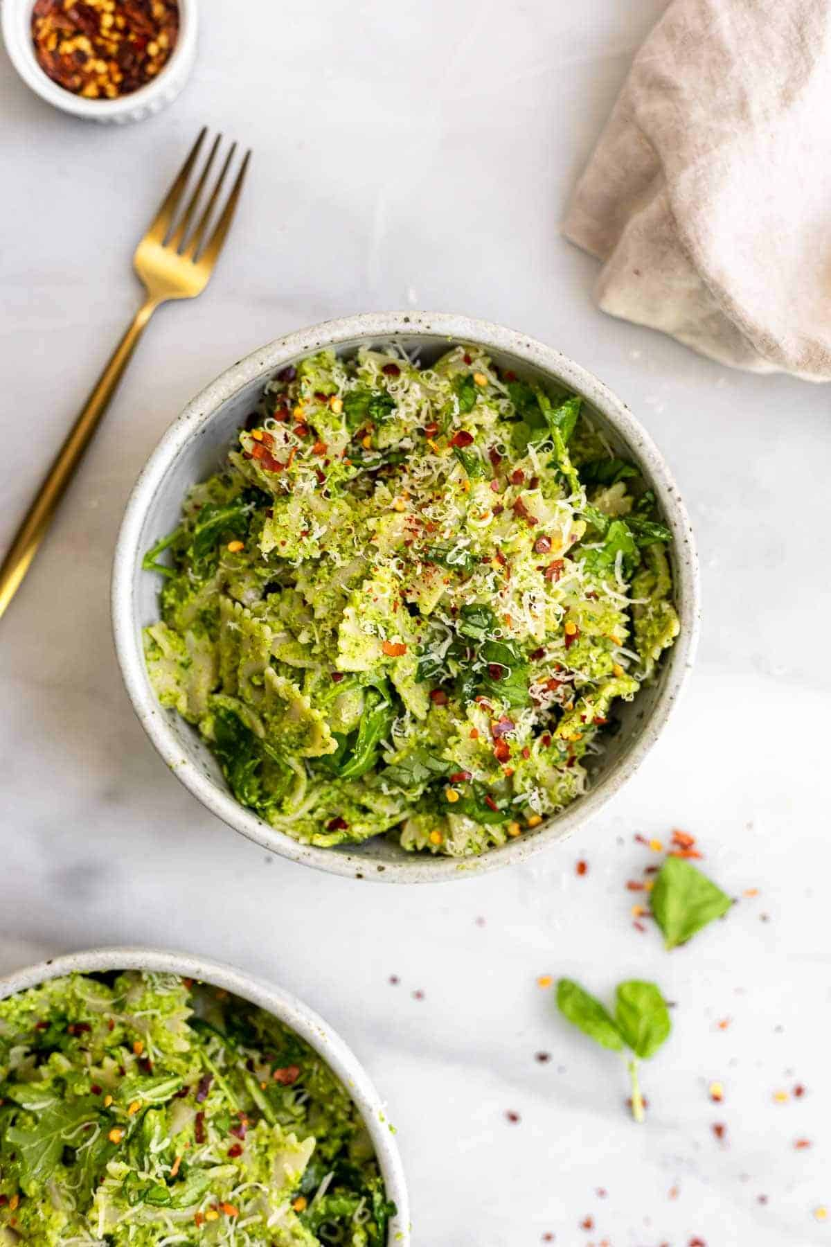 Broccoli pesto pasta with cheese on top.