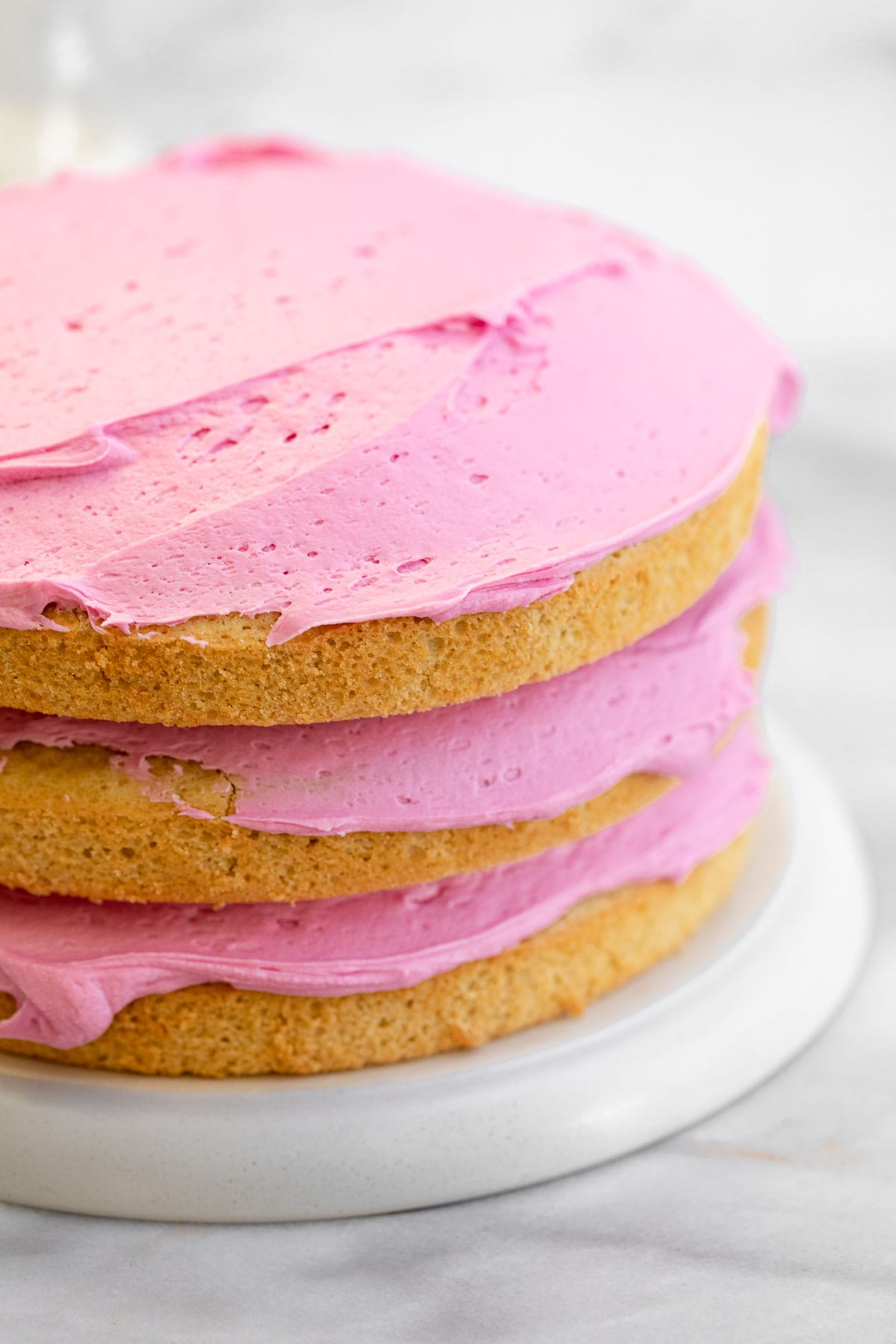 three layer gluten free cake with pink frosting