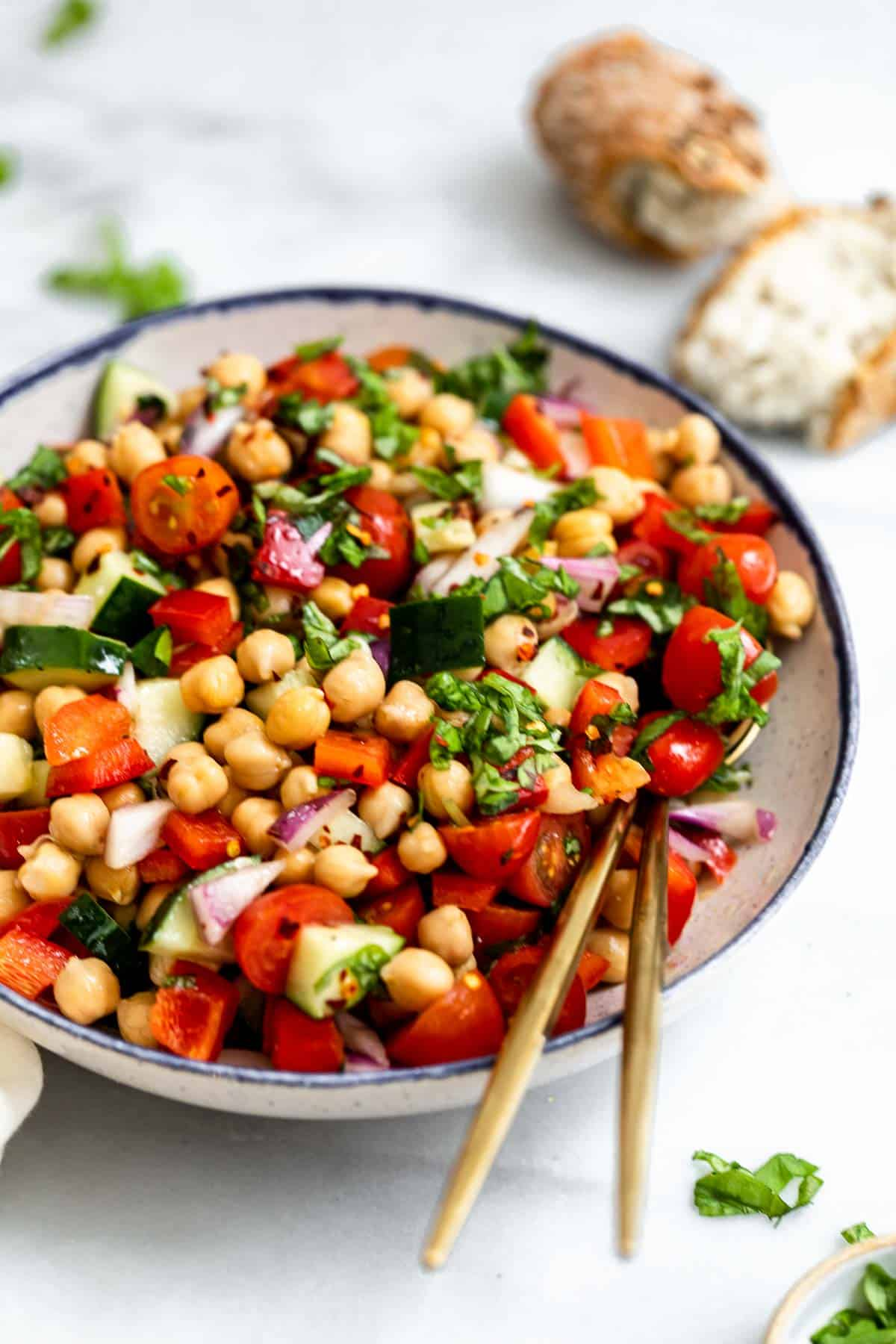 angled view of the mediterranean chickpea salad with fresh basil