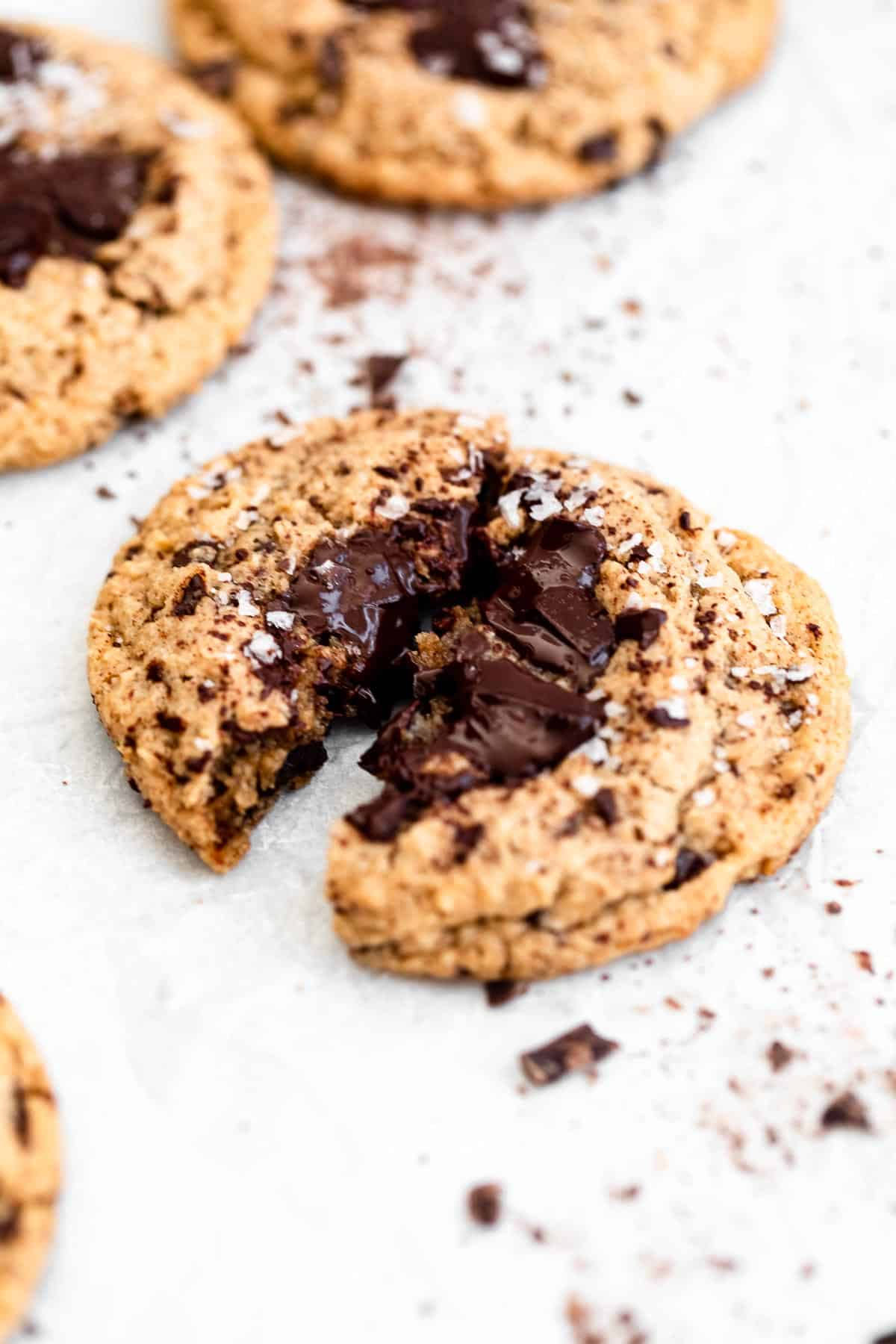 one cookie ripped in half to show melted chocolate