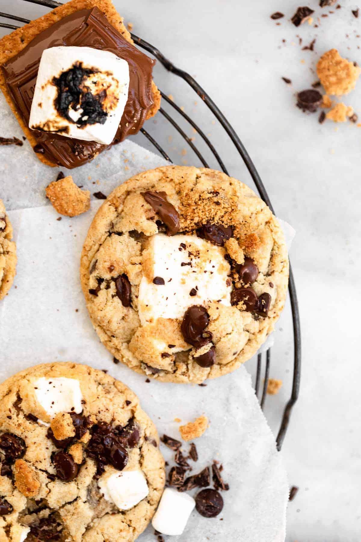 marshmallow smores cookies with melted chocolate on a wire rack