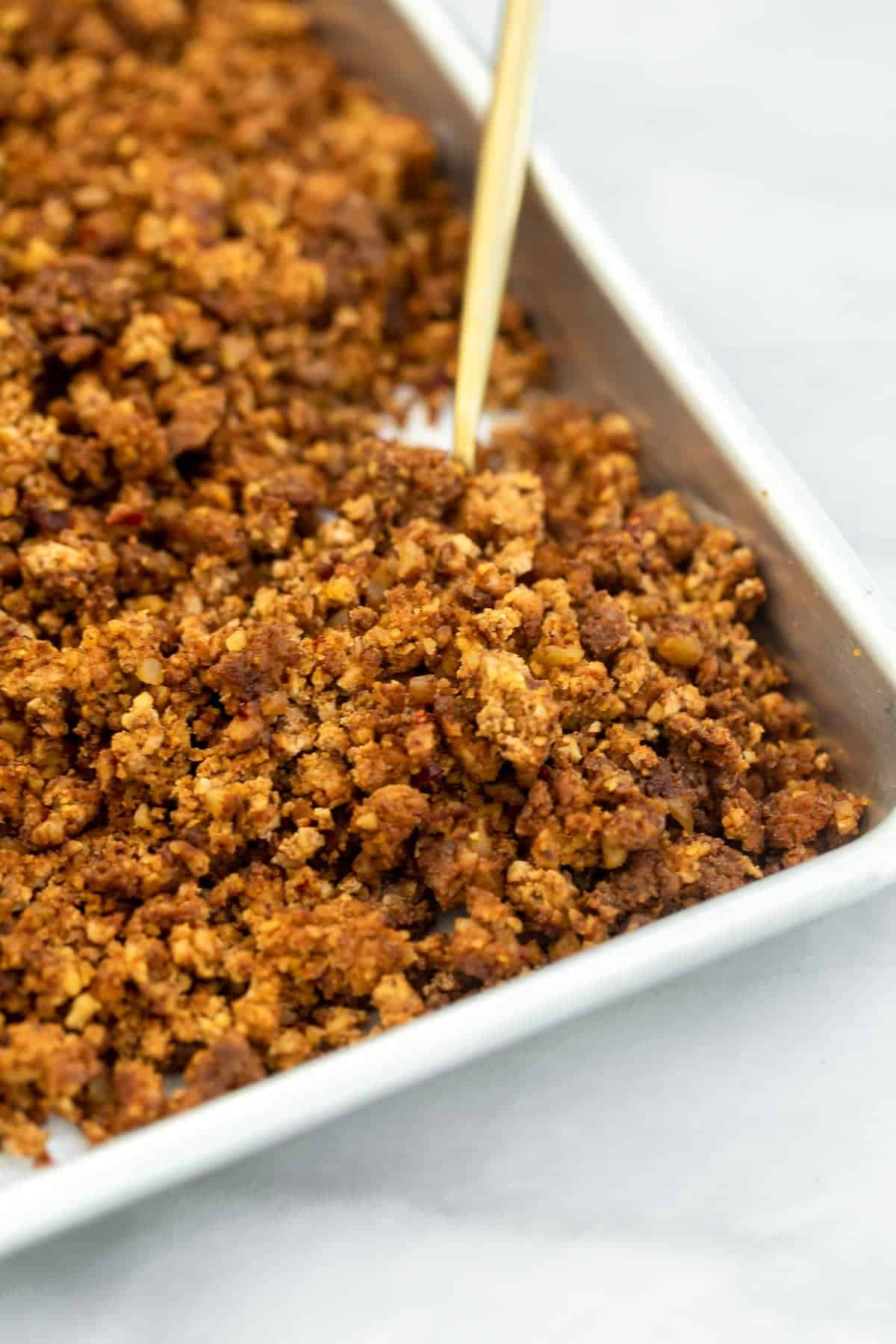tofu and walnut taco meat on a baking sheet