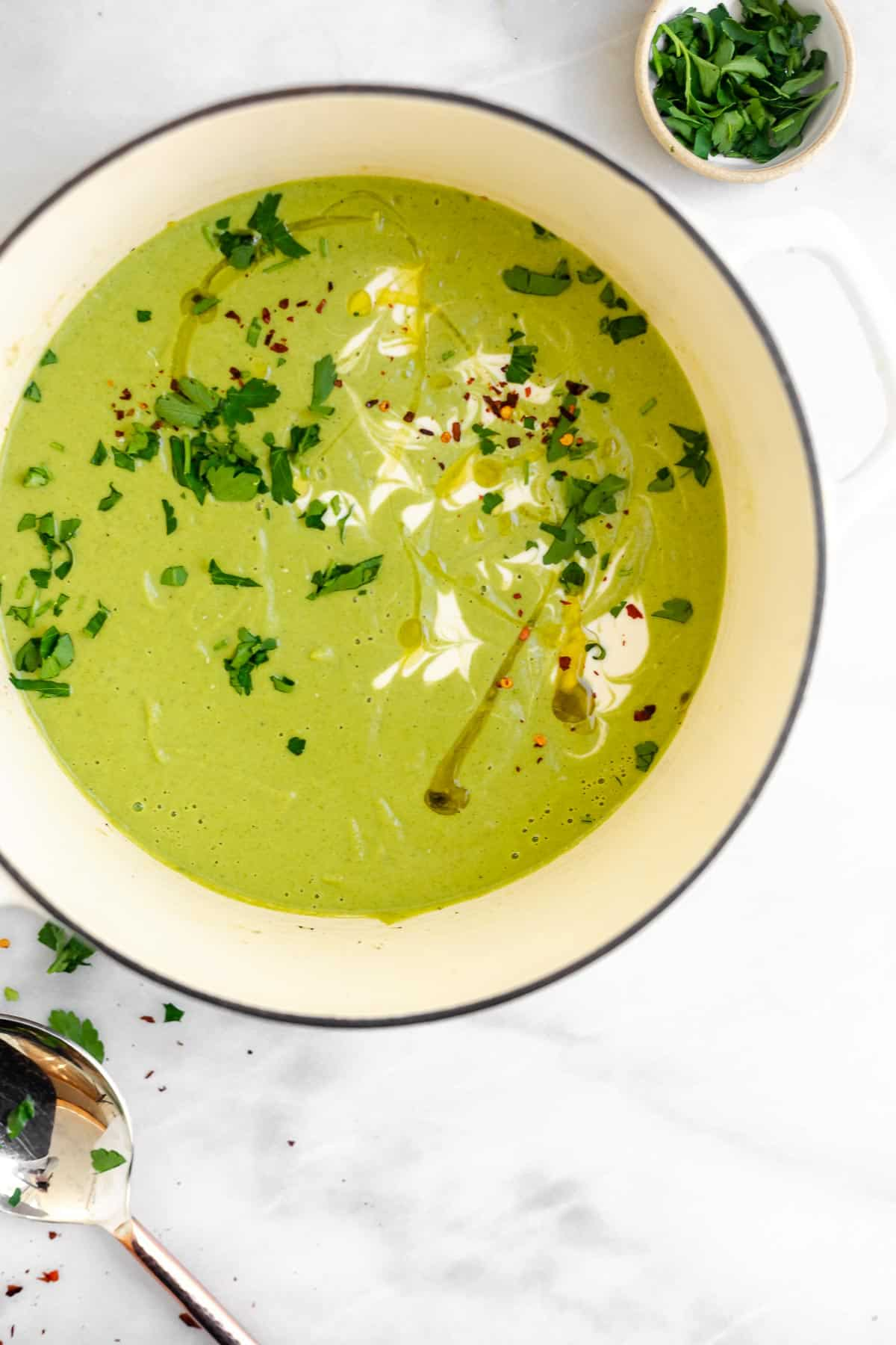 large white pot with vegan cream of broccoli soup
