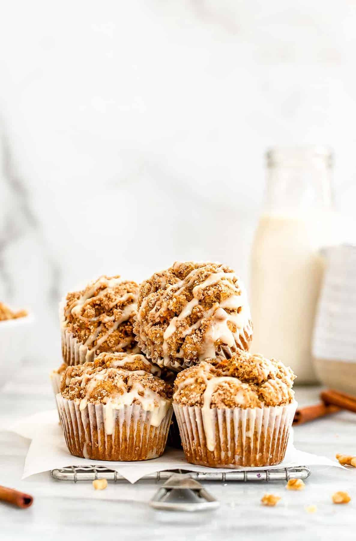 carrot cake muffins stacked on a wire rack