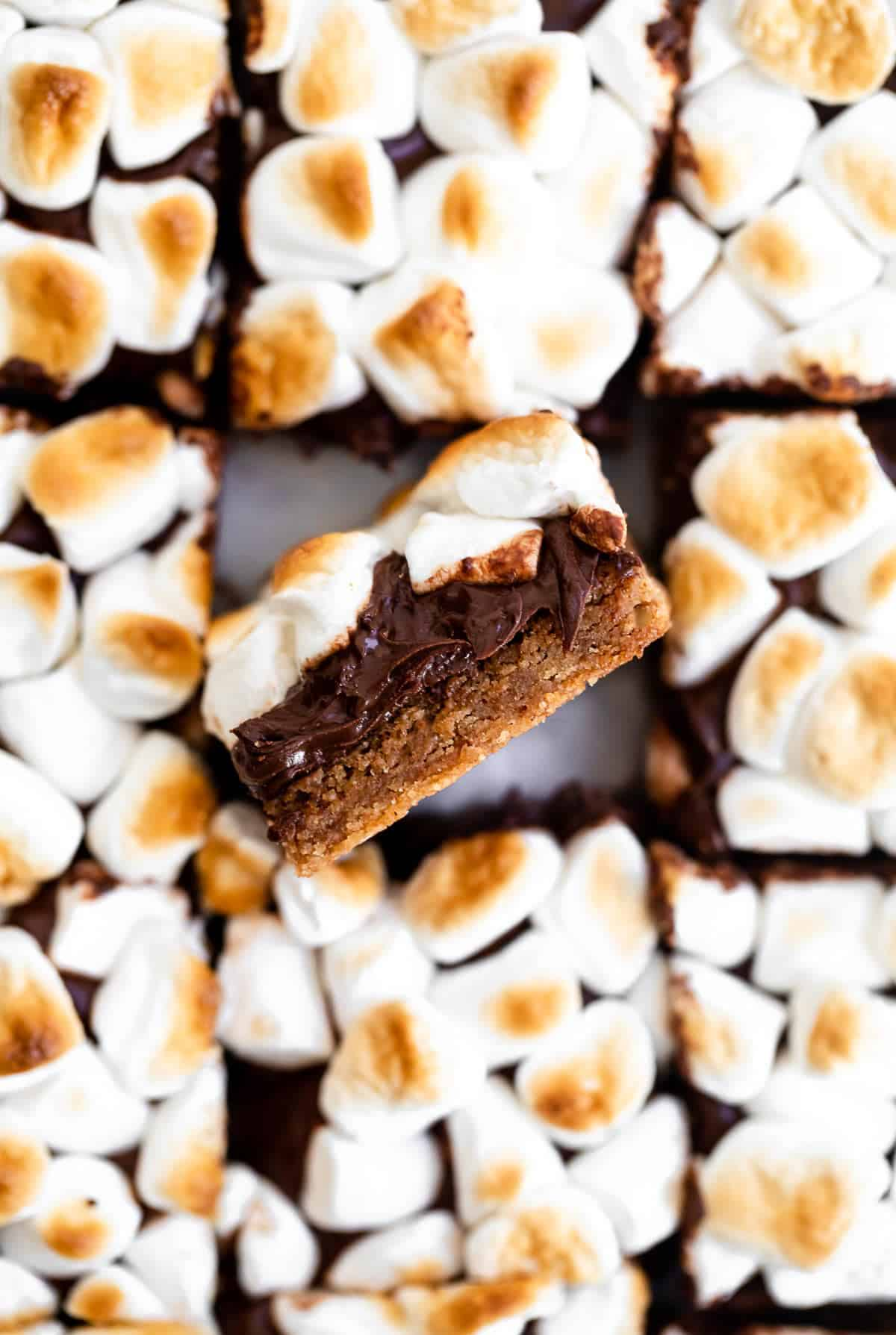 Overhead shot of vegan smore's bars with one on the side to show melted chocolate.
