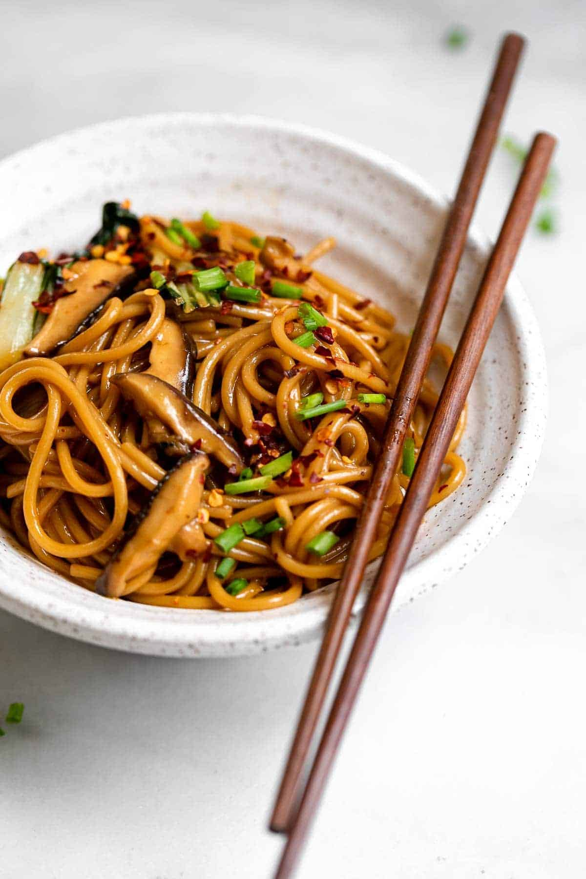 up close image of the noodles with chopsticks on the side