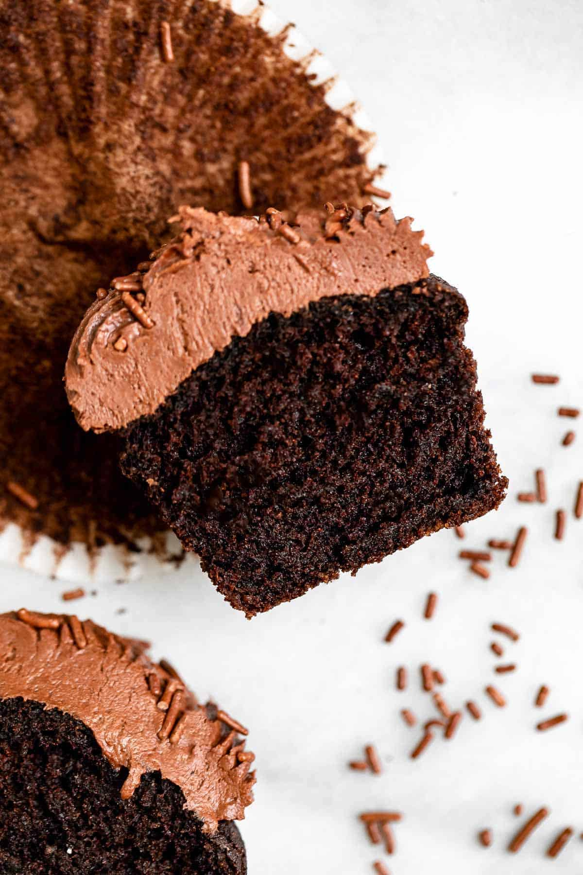 one chocolate cupcake cut in half to show moist texture