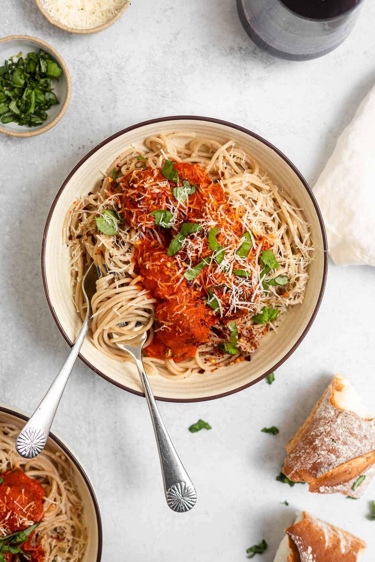 vegan lentil meatballs in a bowl with spaghetti