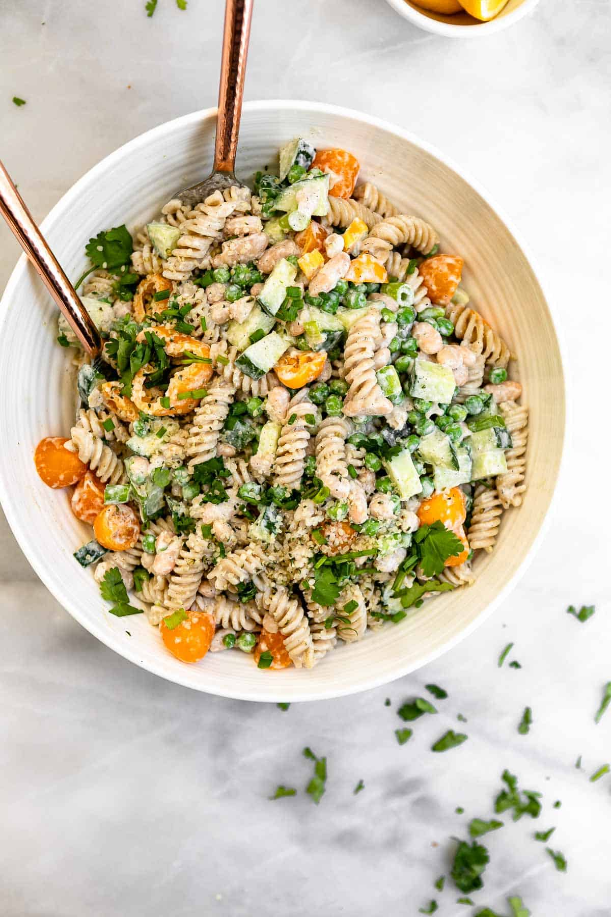 large white bowl with the pasta salad with fresh herbs