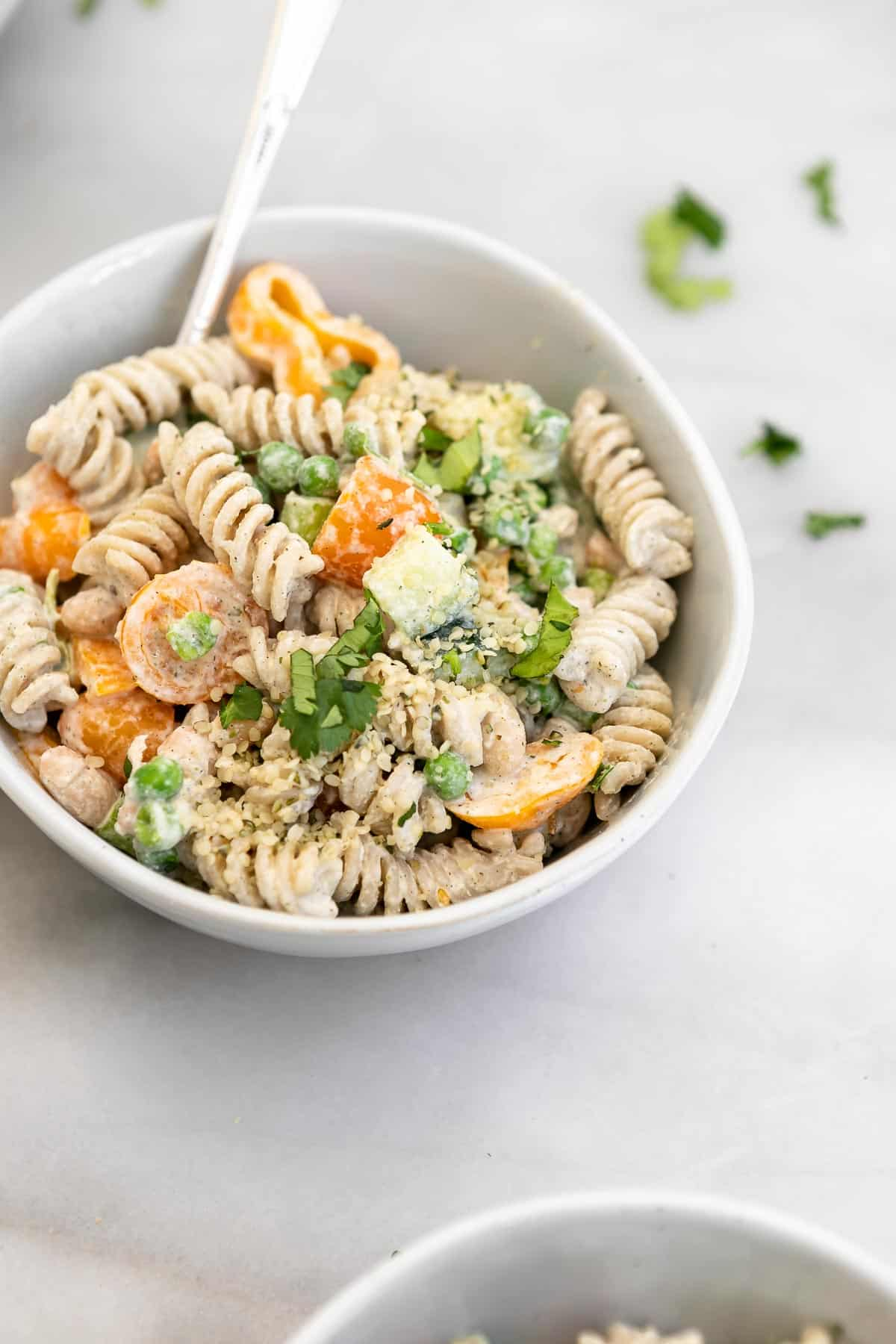 vegan pasta salad in a small bowl with cilantro