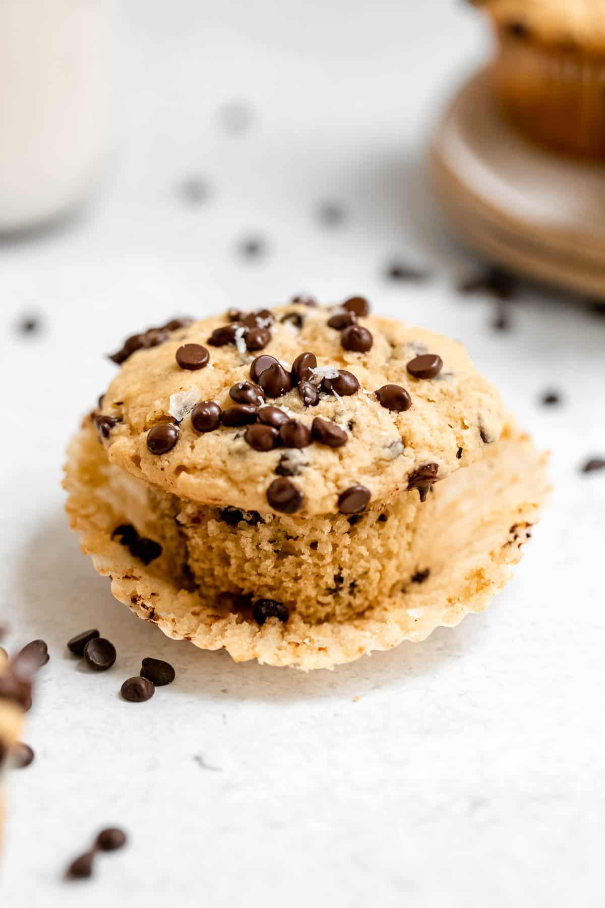 one muffin with the wrapped pulled off with chocolate chips on top