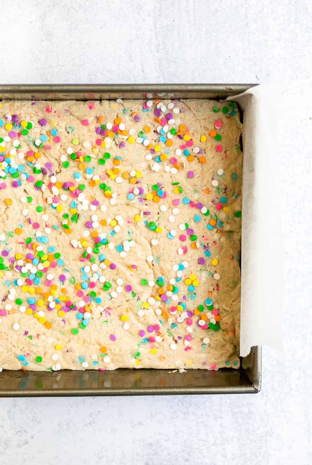 dough in a baking pan before baking