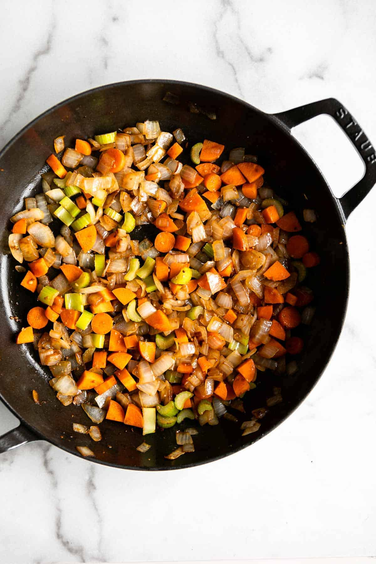 sauteing the carrots for the sauce