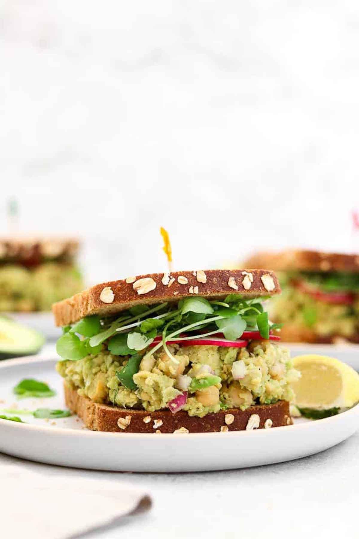 Final recipe in a sandwich on a plate.
