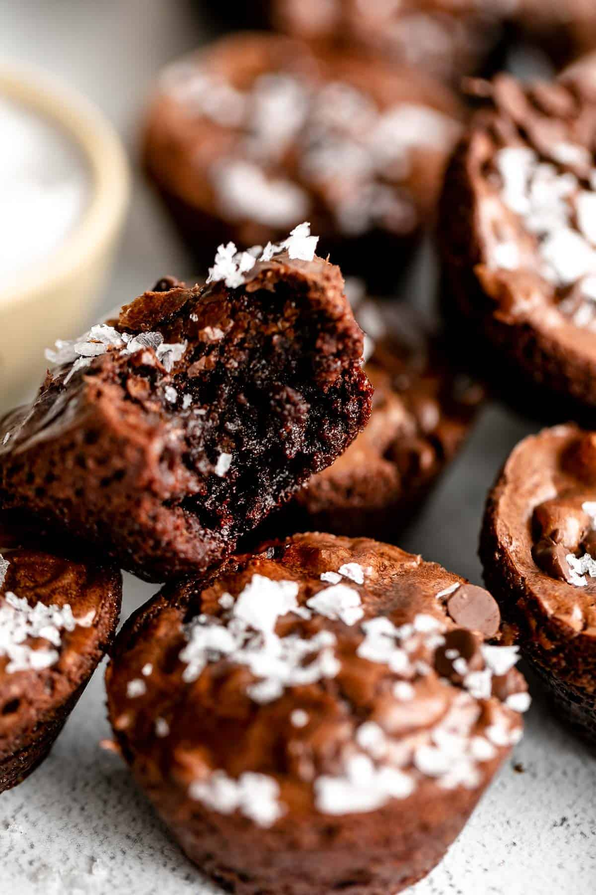 brownie bites with one bite taken out to show texture