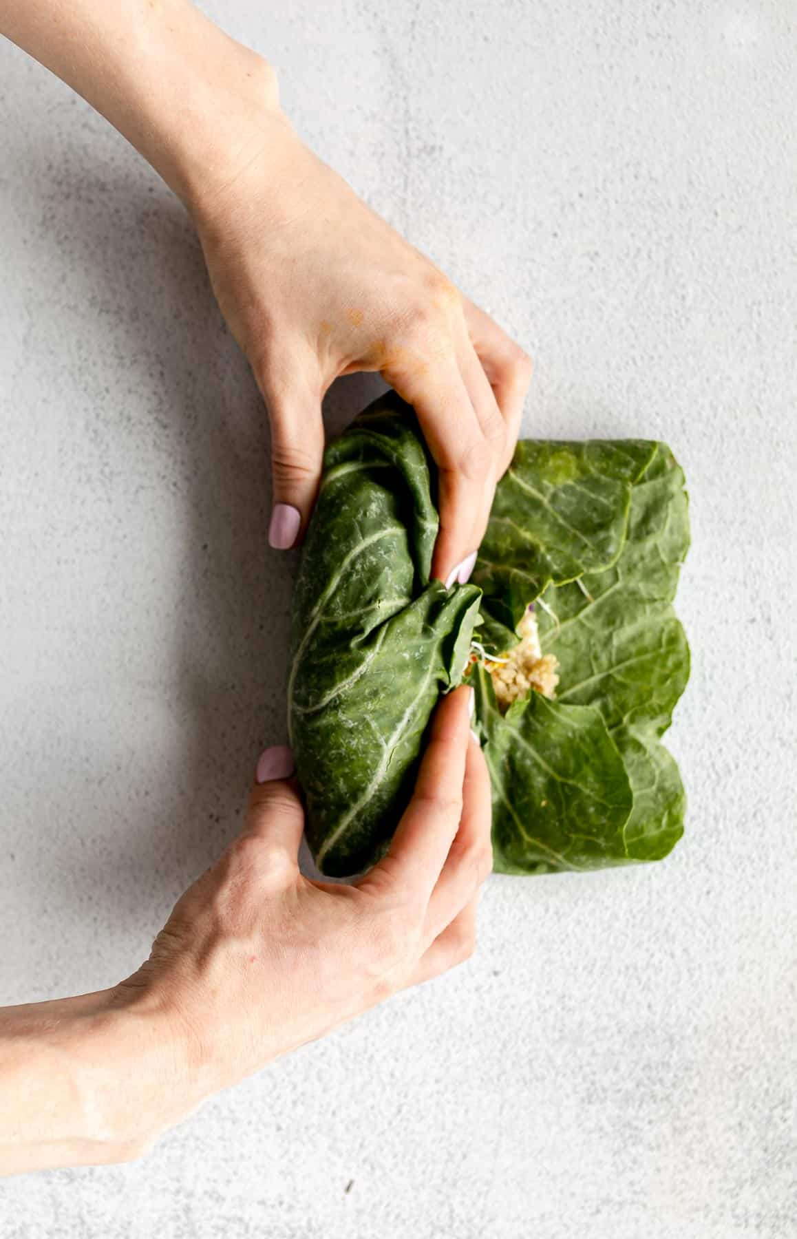 rolling up the collard leaves