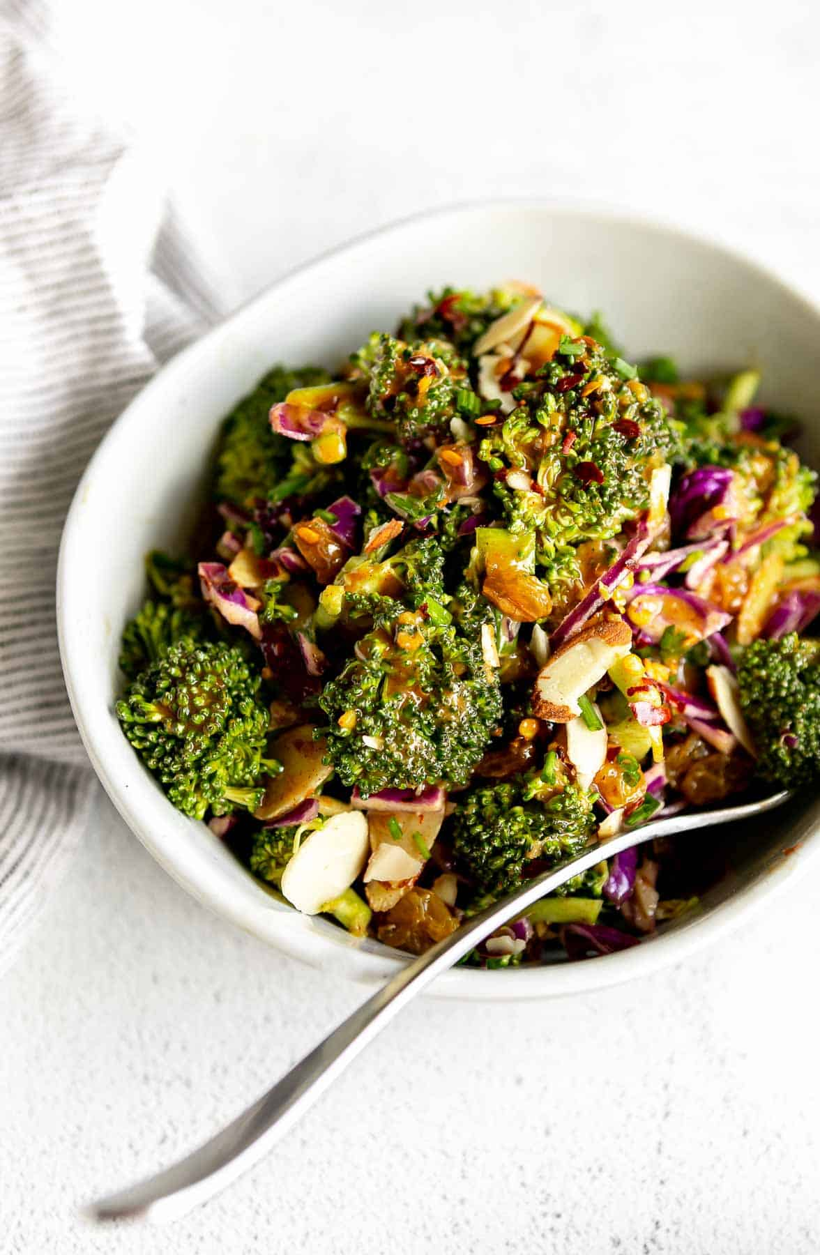angled view of the broccoli salad with sliced almonds