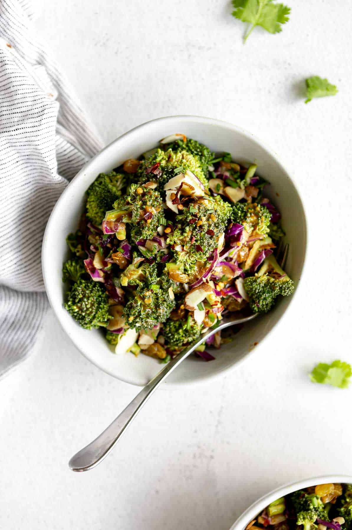 vegan broccoli salad in a bowl with almond dressing