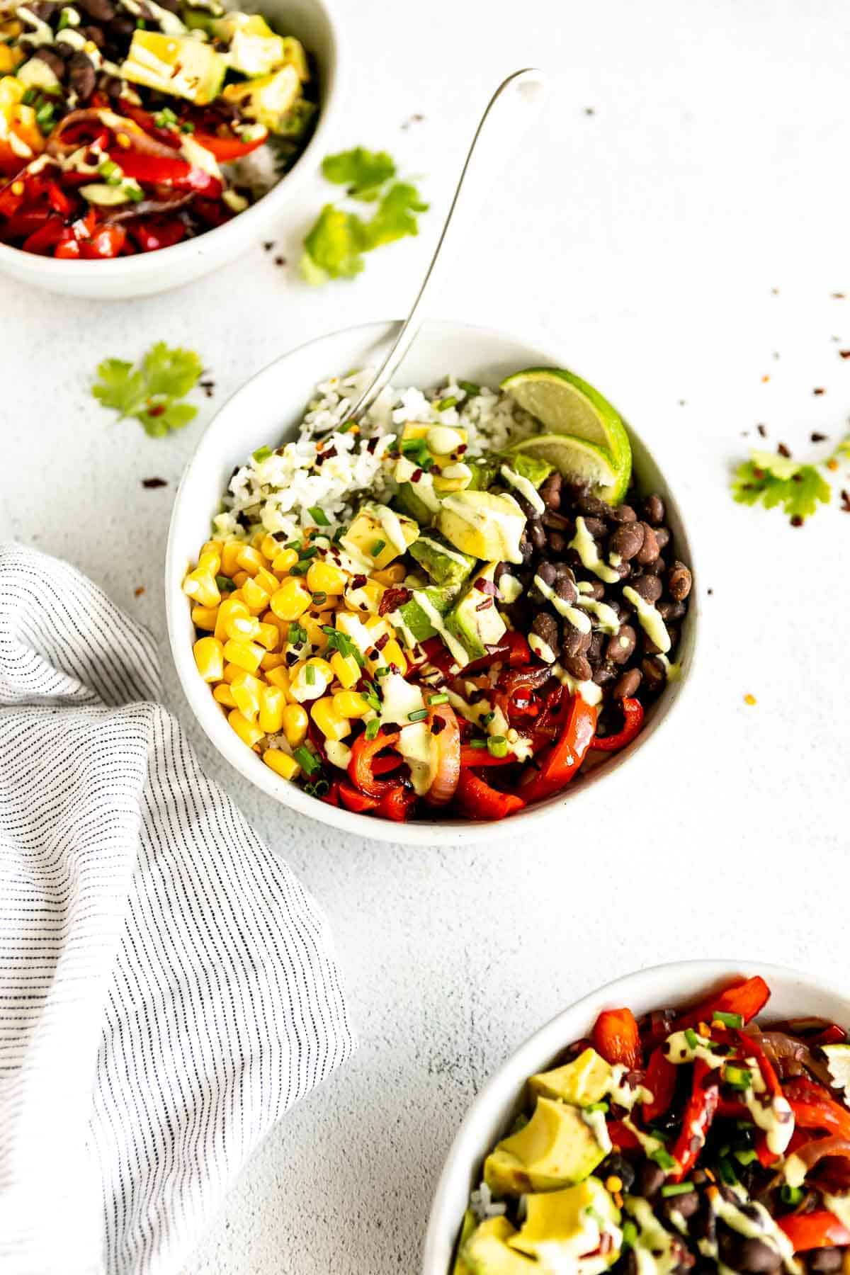 burrito bowl with cilantro lime rice and black beans on a white backdrop