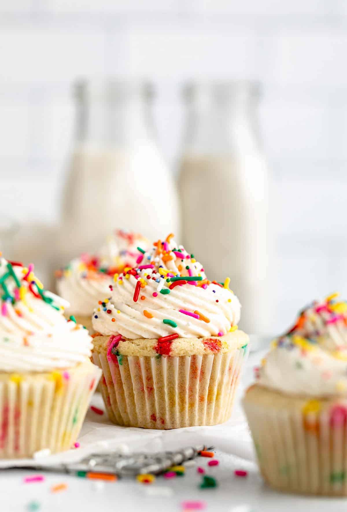vegan gluten free cupcakes with milk in the back