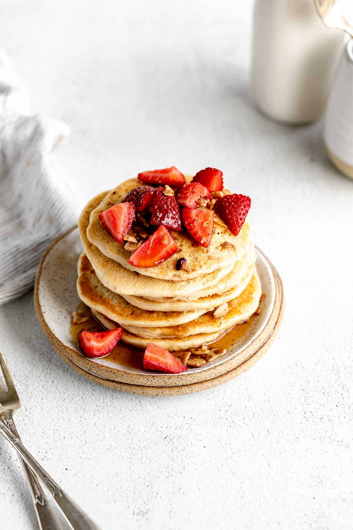 stack of vegan protein pancakes with strawberries on top
