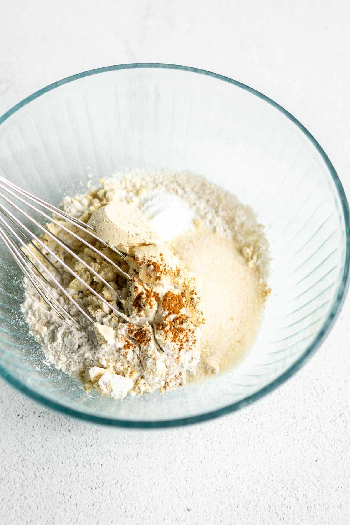 dry ingredients in a bowl with a whisk