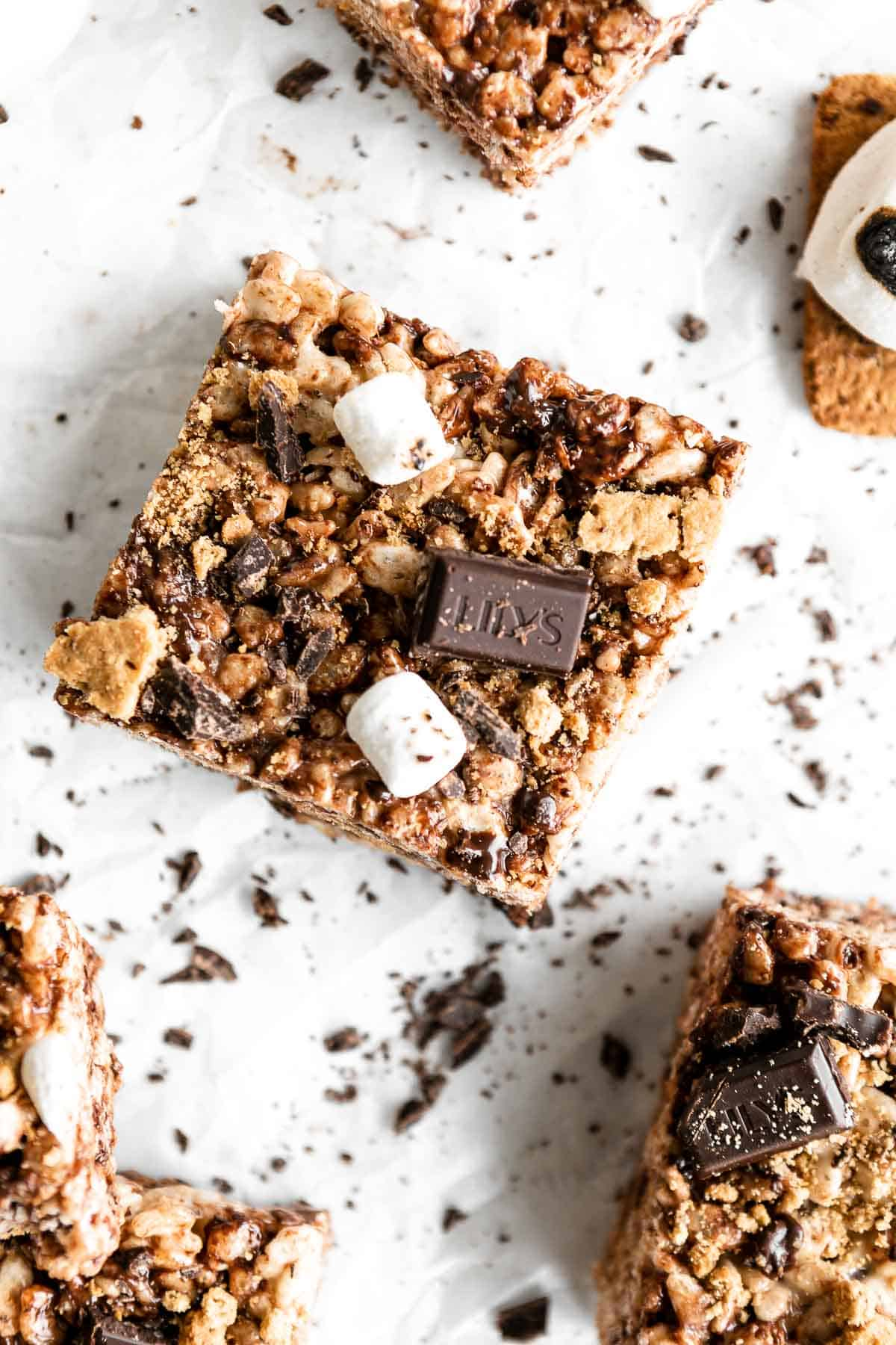 overhead shot of one vegan rice krispie treat with marshmallows and chocolate